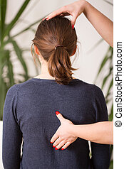 Correct posture - Therapist setting young woman in correct...