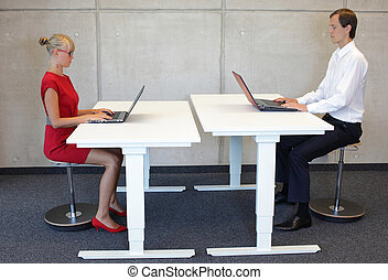 correct sitting posture - office work - coworkers in correct...