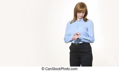 corrects cuff. girl in pants and blous.  Isolated on white background. body language. women gestures. nonverbal cues