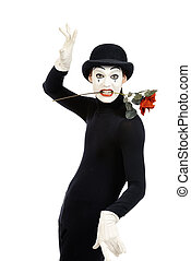 corrida - Emotional male mime artist with red rose...