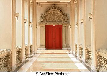 corridor - Pathway to Red Wooden Door