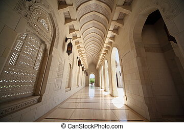 corridor with arcs inside Grand Mosque in Oman. Wide Angle.
