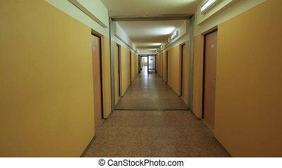 Corridor with yellow walls - Plain corridor of a dormitory...