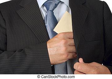 Corruption - Businessman putting an envelope in his jacket...