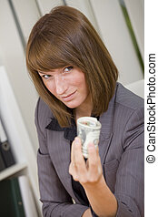 corruption - businesswoman holding money in her hand by...