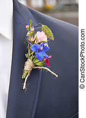 corsage at a suit of a groom
