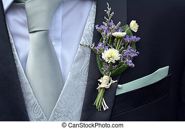 Corsage boutonniere brooch on groom suit - Corsage ...