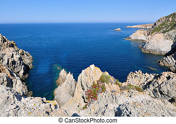 Corsica rock coast - cliffs overlooking the sea under blue ...