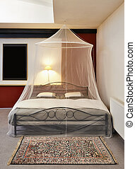 Cosi vintage bed with mosquito Net in a restored loft