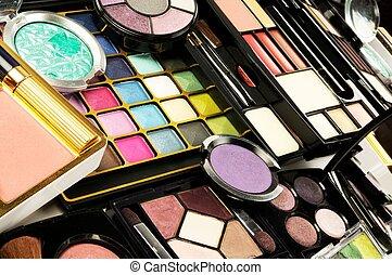 Lot of decorative colorful makeup sets , close up shot
