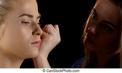Cosmetic beauty procedures and makeover concept. Makeup. Black. Closeup