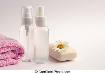 Cosmetic bottle containers with camomole flowers, Blank label package for branding mock-up, Natural organic beauty product concept