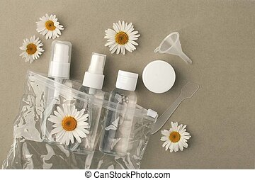 Cosmetic bottle containers with hermal camomile flowers Blank label for branding mock-up, Natural organic beauty product concept.