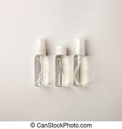 Cosmetic bottle containers with natural ingredients, Blank label for branding mock-up, Natural beauty product concept, Flat lay
