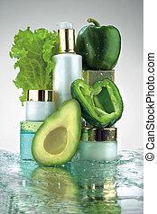 Cosmetic bottles and veggies - A studio arrangement of...