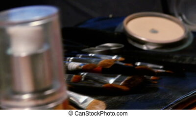 Cosmetic brushes on a table