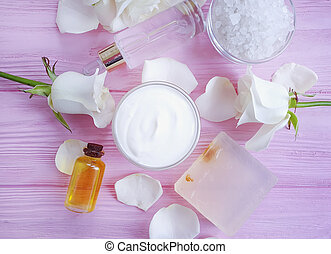 cosmetic cream, rose flower, soap on wooden