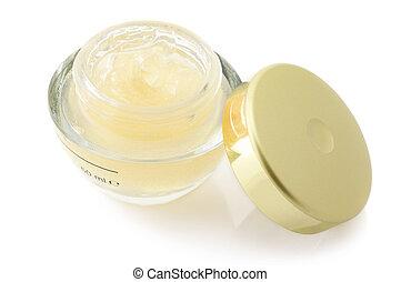 Cosmetic cream - Opened jar of cosmetic cream isolated on...
