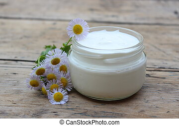 Cosmetic cream with chamomile flowers