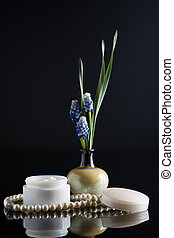 cosmetic cream with floral composition