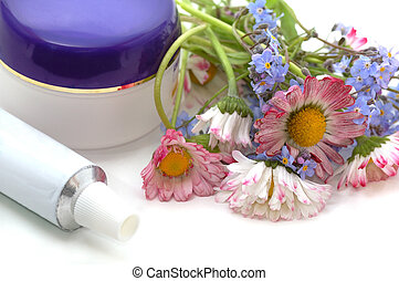 cosmetic cream with flowers - blank containers for cosmetic...