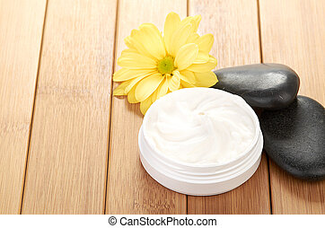 cosmetic cream with herbal flower