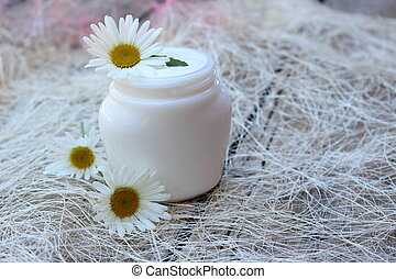 Cosmetic cream with white camomile flower