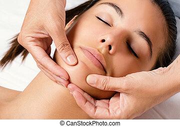 Cosmetic female chin massage.