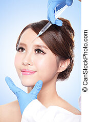 cosmetic injection to the pretty woman face - Close up of...