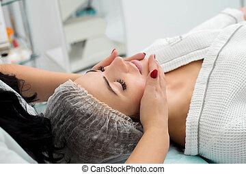 Cosmetic massage, facial treatment.