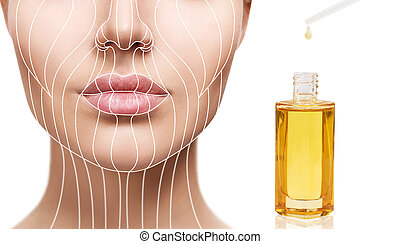 Cosmetic oil applying on young woman with lifting lines.