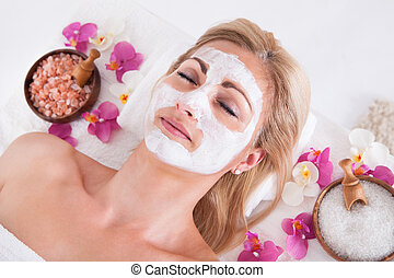 Cosmetician Applying Facial Mask On Face Of Woman - ...