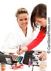 Cosmetician doing makeup - Cosmetician applying makeup to a...
