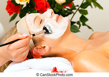 Cosmetics and Beauty - applying facial mask - Woman having a...