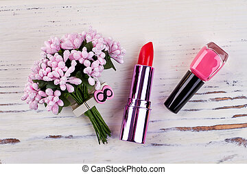 Cosmetics and flowers.