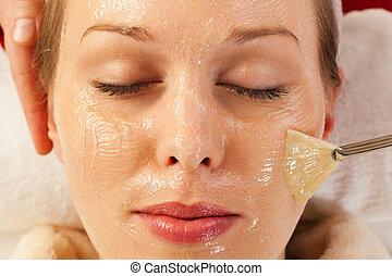 Cosmetics - applying facial mask