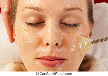 Cosmetics - applying facial mask