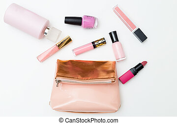 Cosmetics for make-up of pink color on a white background. Flat lay
