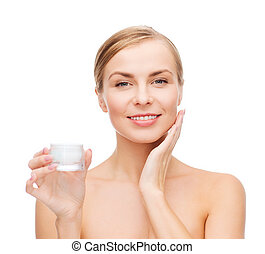 woman applying cream on her skin - cosmetics, health and ...