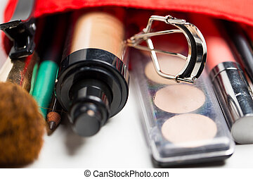 close up of cosmetic bag with makeup stuff - cosmetics, ...