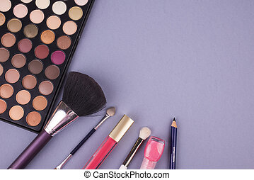 cosmetics on a gray background