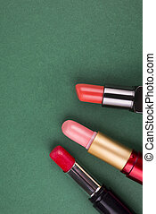 cosmetics on a green background