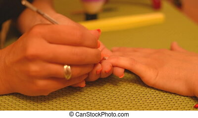 Cosmetologist making preparations for manicure