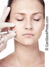 Cosmetology - A girl makes a procedure Botox