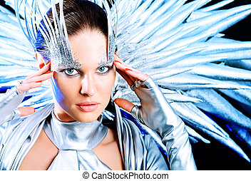 cosmic - Fashion shot of a beautiful young woman over dark...