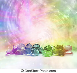 Selection of rainbow colored crystals on a rainbow colored swirling energy background with sparkles