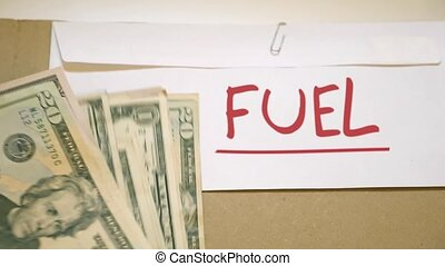 Cost of fuel and energy concept - USD bills on fuel money...