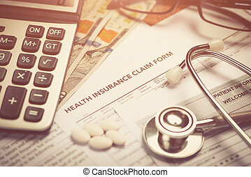 Cost of health care concept, stethoscope and calculator on table
