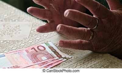 Cost of living of senior sitizens, hands of senior woman on...