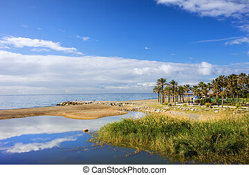 Beautiful nature scenery between Marbella and Puerto Banus where the Green River (Spanish: Rio Verde) meets the Mediterranean Sea on Costa del Sol, Andalusia region, Malaga province, Spain